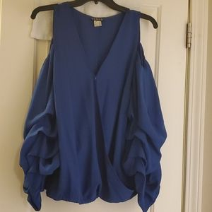 Preowned worn once cold shoulder blouse.